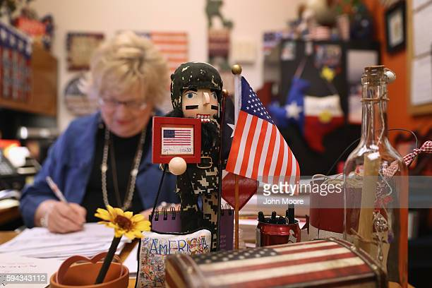 S Citizenship and Immigration Services supervisor her office patriotically festooned reviews citizenship applications in the Dallas Field Office on...