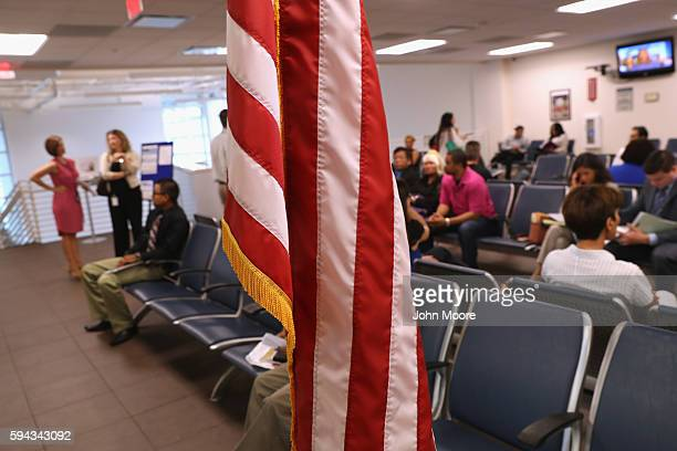 Citizenship applicants await interviews at the US Citizenship and Immigration Services Dallas Field Office on August 22 2016 in Irving Texas The...