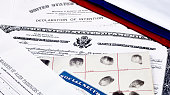 Certificate of US Citizenship, social security card, declaration of intention, and passenger manifest with red, white and blue ribbon