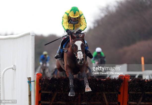 Citizenship ridden by Aidan Coleman jumps the last on their way to victory in the Exeter Racecourse Wishes You A Happy Christmas Handicap Hurdle...
