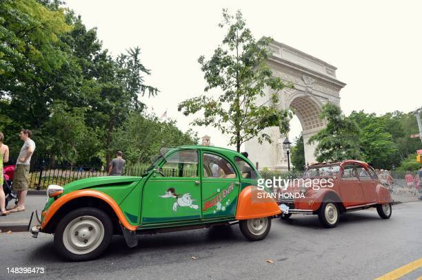 Citroen 2CV cars parked by the Washington Square Park arch ON July 15 2012 during the 13th Annual Bastille Day Rally and Rendez Vouz of the Greater...