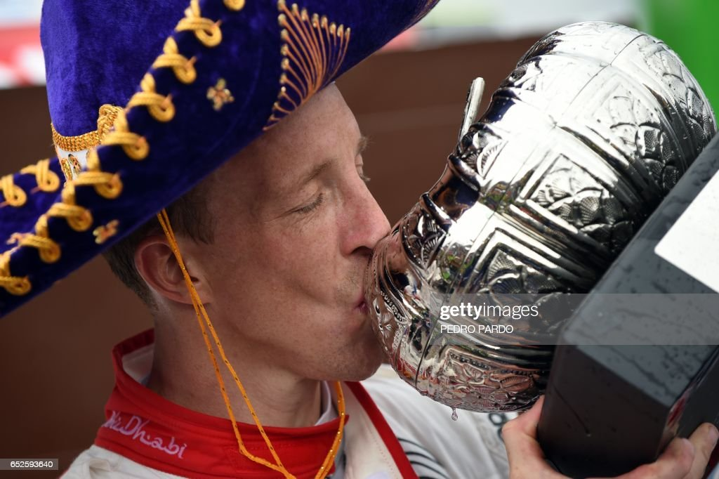 Citroen C3 WRC British driver Kris Meeke kisses his trophy as he celebrates their victory following the 2017 FIA World Rally Championship in Leon, Guanajuato State, Mexico on March 12, 2017. /