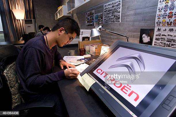 A Citroen car designer works in PSA Peugeot Citroen China Tech Center on April 9 2010 in the outskirts of Shanghai China