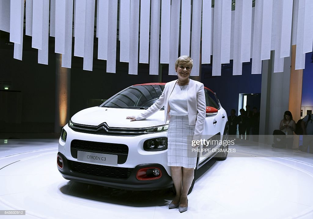 Citroen's Chief Executive Officer (CEO) Linda Jackson poses next to the new Citroen C3 during its unveiling on June 29, 2016 in Lyon. / AFP / PHILIPPE