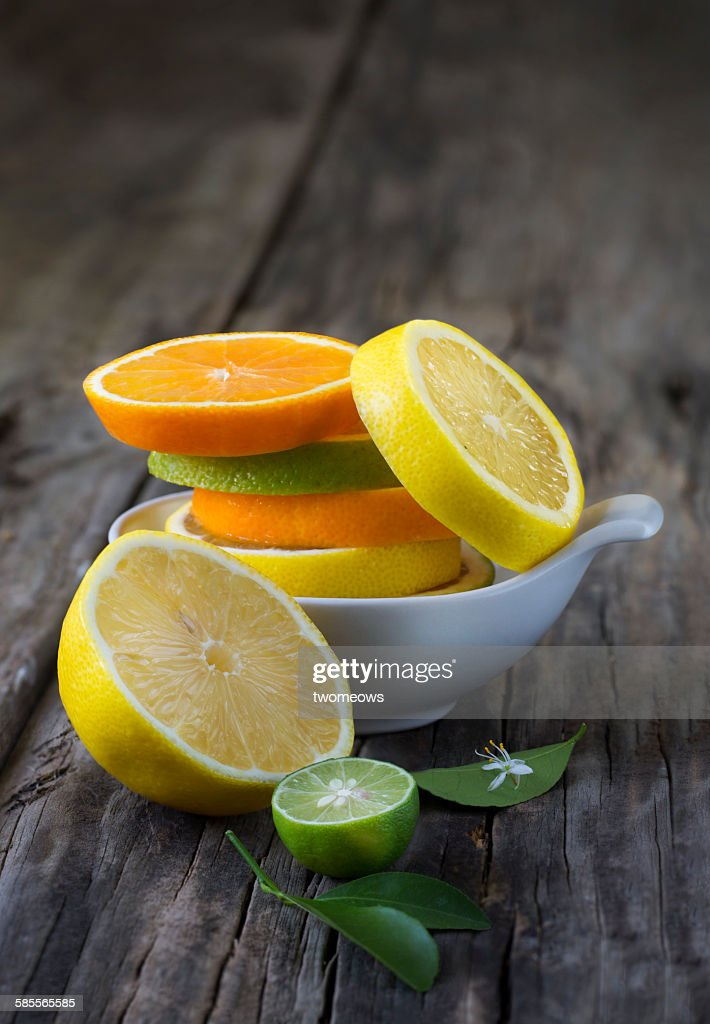 Citrus fruit slice on wooden background