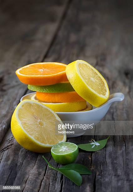 Citrus fruit slice on wooden background