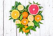 Citrus fruits heart shape vitamin C  on white background.