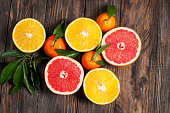 Citrus fruits. Oranges, grapefruits and mandarins. Over wooden table background. Top view.