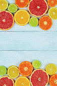 Citrus fruits. Oranges, limes, grapefruits, tangerines and lemons. Over white wood table background with copy space. Top view