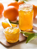 Citrus jam in glass jar, selective focus