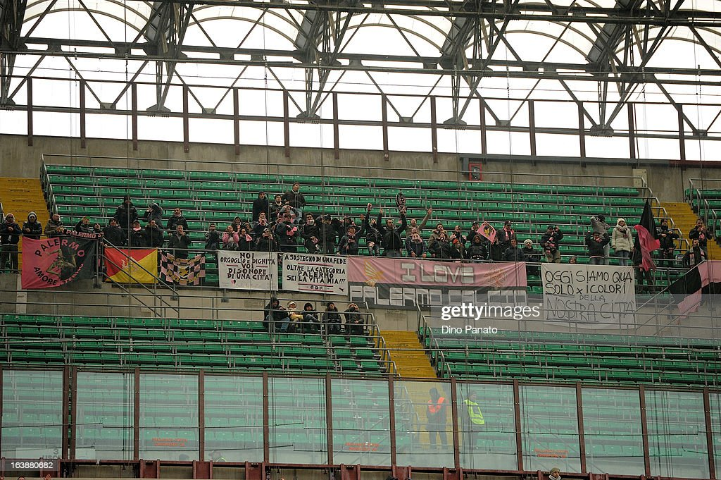 US Citta di Palermo fans display a banner as they show their support during the Serie A match between AC Milan and US Citta di Palermo at San Siro Stadium on March 17, 2013 in Milan, Italy.