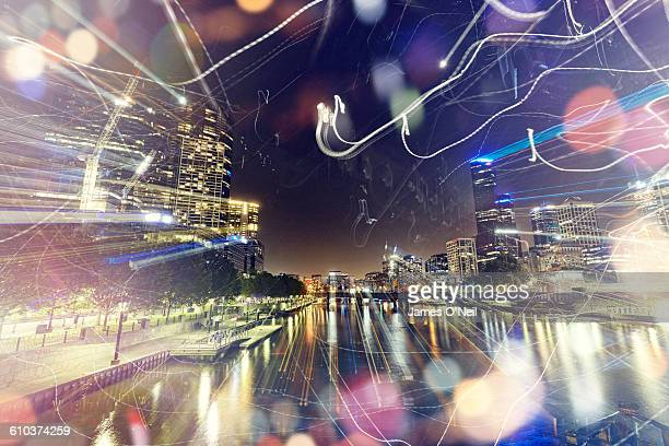 city at night with abstract light trails