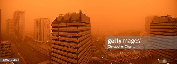 City buildings encased by red dust storm