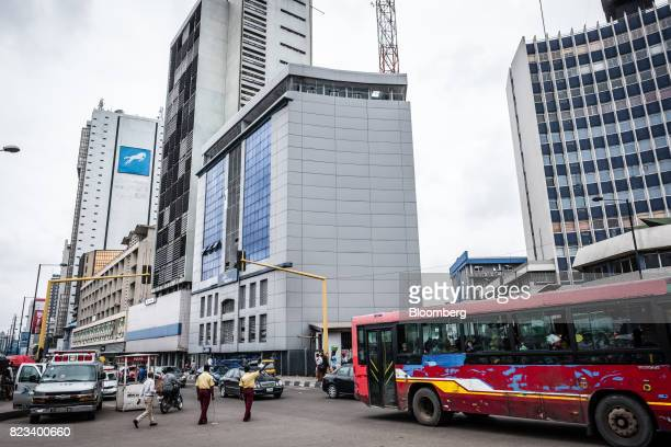 A city bus drives past office buildings in Lagos Nigeria on Wednesday July 26 2017 Nigeria's economy which in 2016 suffered its first fullyear...