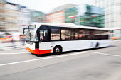 driving bus in the city with motion blur