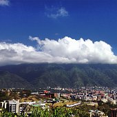 City By Mountains Against Sky