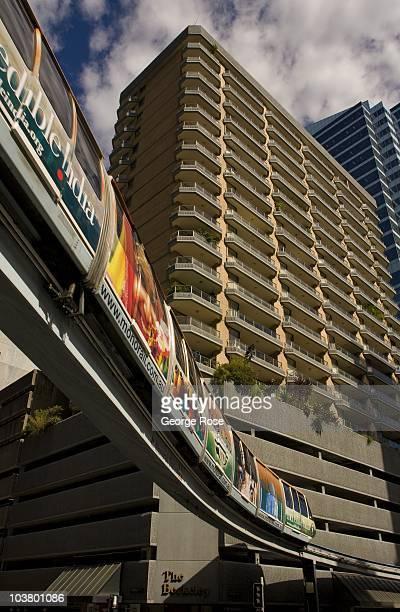 City Centre monorail train passes below a new condominium building on August 10 2010 Sydney Australia Sydney a major destination for global travelers...
