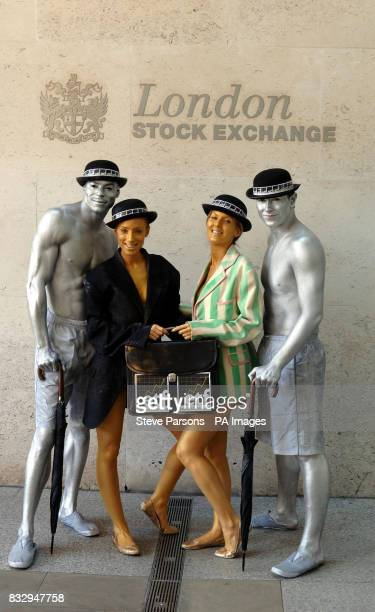 City characters covered in body paint outside the London Stock Exchange London to mark the launch of an investment product allowing investors direct...
