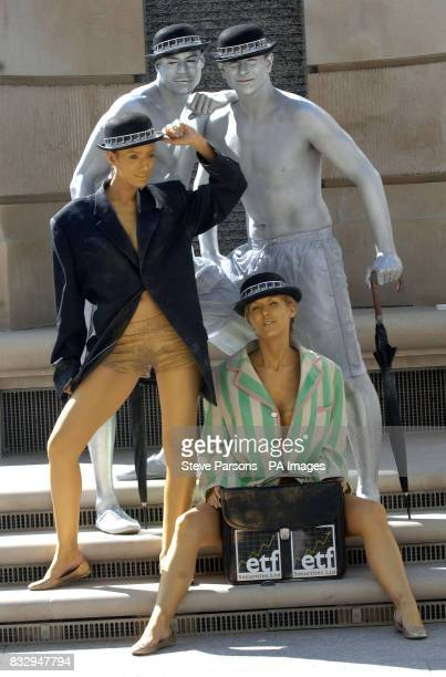 City characters covered in body paint outside the London Stock Exchange London to mark the launch of an investment product from ETF Securities...