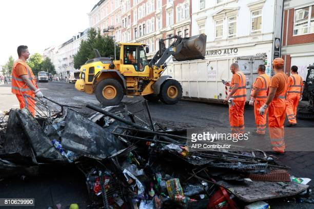 City cleaners remove debris after riots in Hamburg's Schanzenviertel district on July 8 2017 in Hamburg northern Germany where leaders of the world's...