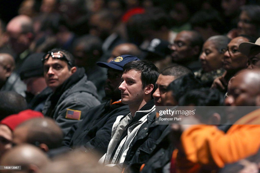 City College students watch as New York Governor <a gi-track='captionPersonalityLinkClicked' href=/galleries/search?phrase=Andrew+Cuomo&family=editorial&specificpeople=228332 ng-click='$event.stopPropagation()'>Andrew Cuomo</a> delivers his State of the State and budget proposals at The City College of New York on February 6, 2013 in New York City. Among issues addressed were the cost of the recovery from Hurricane Sandy, policing, economic development and education. His $142.6 million executive budget would increase state spending by 2 percent and raise school aid by 4.4 percent, to $21 billion.
