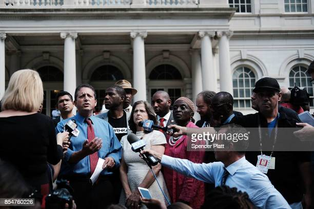 City Council Member Brad Lander speaks to the media after he and other members 'took a knee' on the steps of City Hall in reaction to President...