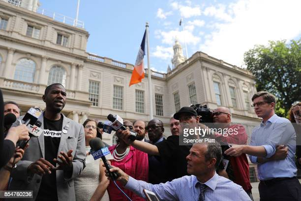 City Council Member Jumaane Williams speaks to the media after he and other members 'took a knee' on the steps of City Hall in reaction to President...