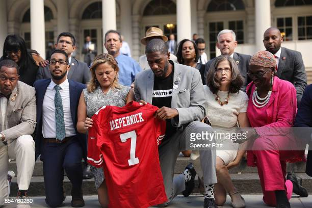 City Council Members including Jumaane Williams and Melissa MarkViverto 'take a knee' on the steps of City Hall in reaction to President Donald...