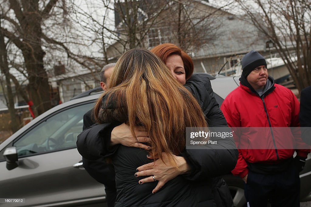 City Council Speaker Christine Quinn hugs Oakwood Beach resident Samantha Langello while touring the heavily flood damaged Staten Island neighborhood on February 5, 2013 in New York City. In a program proposed by New York Governor Andrew Cuomo, New York state could spend up to $400 million to buy out home owners whose properties were destroyed by Superstorm Sandy. The $50.5 billion disaster relief package, which was passed by Congress last month, would be used to fund the program. If the program is adopted, homeowners would be relocated and their land would be left as a natural barrier to help absorb future floods waters.