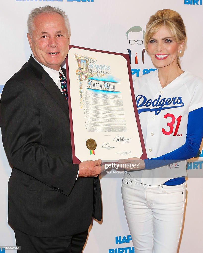 City Councilman Tom LaBonge (L) and Shawn King (R) attend a surprise party for Larry King's 80th Birthday at Dodger Stadium on November 15, 2013 in Los Angeles, California.