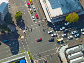 City crossroad scene with traffic lights seen from above