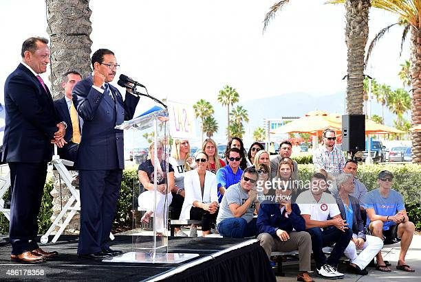 City Cuncil President Herb Wesson along with LA City Councilmember Gilbert Cedillo speak as they are watched by a group of Olympians during a press...