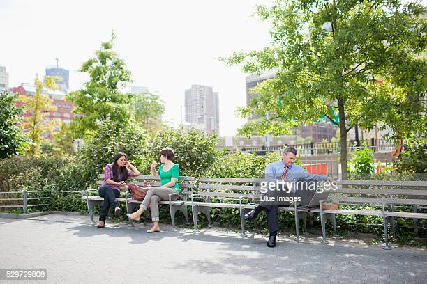 City dwellers sitting in park