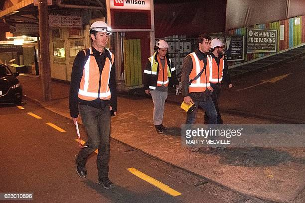 City engineers inspect buildings in the central business district in Wellington on early November 14 following an earthquake centred some 90...