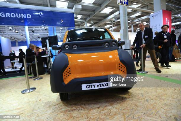 A City eTaxi emission free eMobility vehicle sits on display at the CeBIT 2017 tech fair in Hannover Germany on Monday March 20 2017 Leading edge...