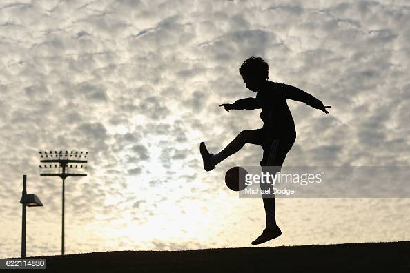 City fan plays with a ball outside the stadium before the round six ALeague match between Melbourne City FC and Newcastle Jets at AAMI Park on...