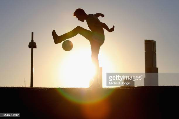 City fan plays with a soccer ball before the round 23 ALeague match between Melbourne City FC and the Newcastle Jets at AAMI Park on March 18 2017 in...