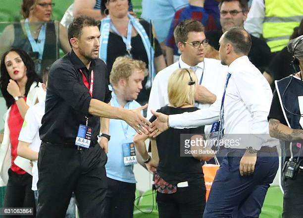 City FC interim coach Michael Valkanis shakes hands with Wanderers coach Tony Popovic after the round 14 ALeague match between Melbourne City FC and...