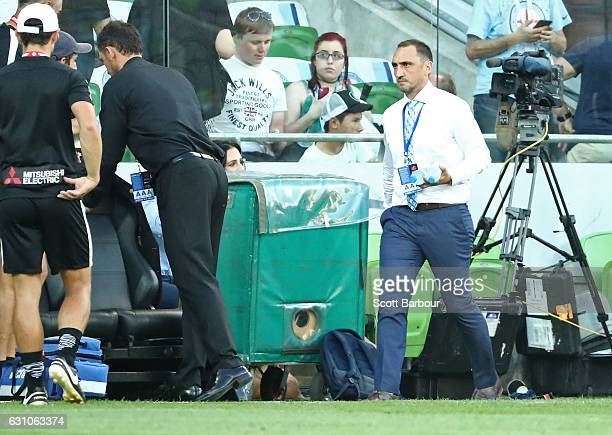 City FC interim coach Michael Valkanis walks towards Wanderers coach Tony Popovic during the round 14 ALeague match between Melbourne City FC and the...