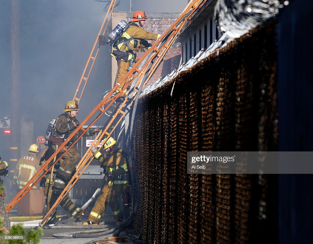 City Firefighters attack a fire in a small commercial building in the 1300 block of Newton Street near downtown Los Angeles Tuesday morning February 09, 2016. A firefighter fell and suffered minor injuries while battling the blaze.