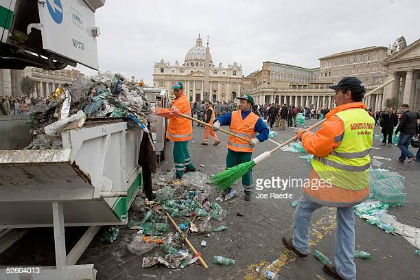 City garbage workers pick up trash left by thousands of people who attended Pope John Paul II's funeral in St Peter's Square April 8 2005 in Vatican...