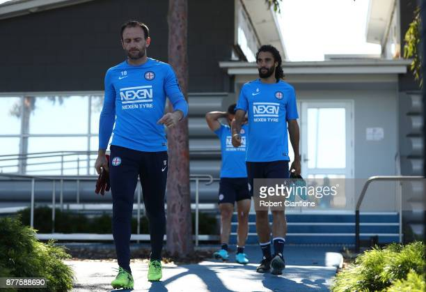 City goalkeeper Eugene Galekovic and Osama Malik of the City arrive for a Melbourne City ALeague training session at City Football Academy on...