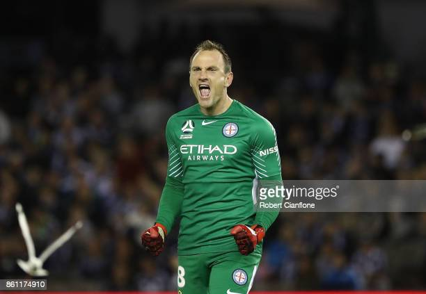 City goalkeeper Eugene Galekovic celebrates the goal of team mate Bruce Kamau during the round two ALeague match between Melbourne Victory and...