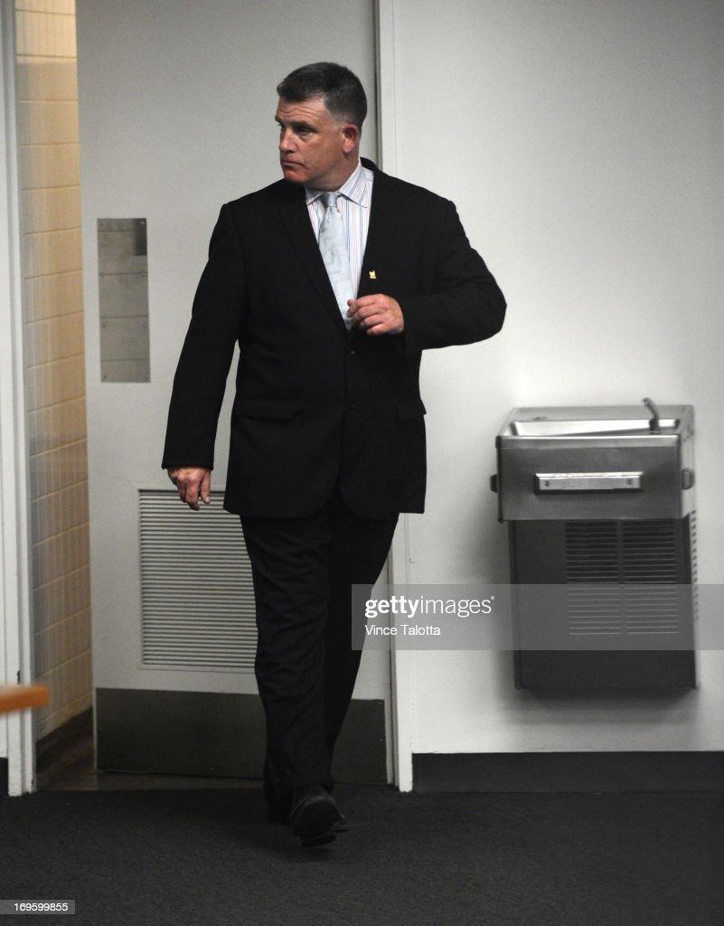 TORONTO, ON - MAY 28 - City Hall aide ,David Price exits the restroom at City Hall in Toronto on May 28, 2013