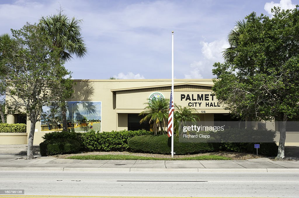 CONTENT] City Hall in Palmetto FL. Flag flying at half-mast.