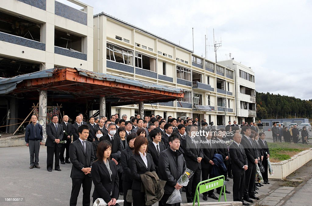 City hall staffs and the relatives of the victims offer silent prayers during the farewell ceremony at former Rikuzentakata City Hall on November 11, 2012 in Rikuzentakata, Iwate, Japan. The building, had designated as emergency evacuation site, caused more than 100 fatalities by the tsunami followed by the strong earthquake. Japan marks 20 months anniversary of the Great East Japan earthquake and following tsunami, occurred on March 11, 2011.