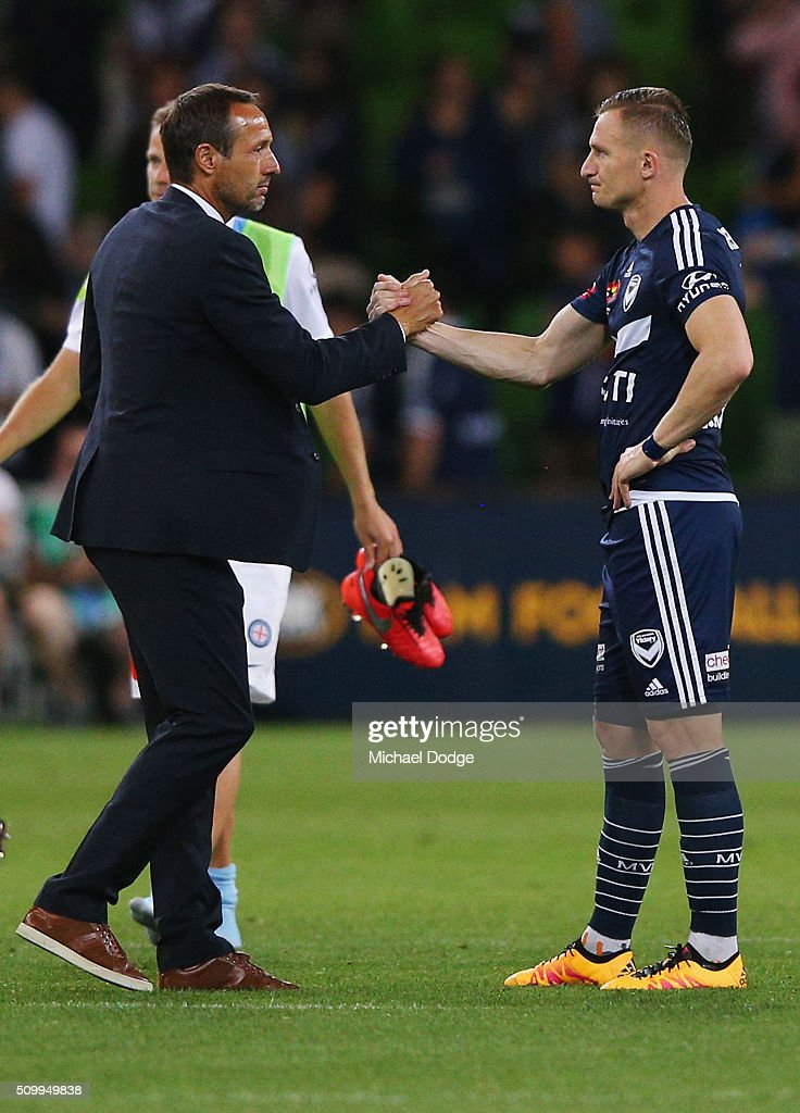 City head coach John van't Schip and Besart Berisha of the Victory shake hands after the drawn round 19 A-League match between Melbourne City FC and Melbourne Victory at AAMI Park on February 13, 2016 in Melbourne, Australia.