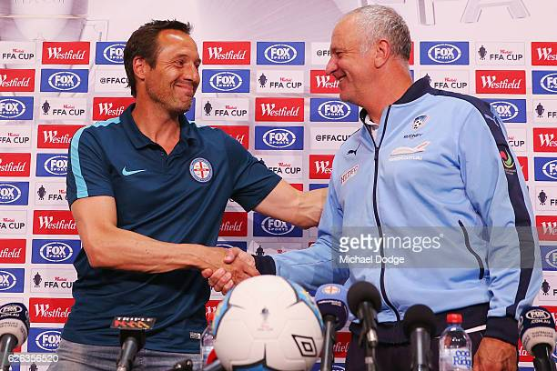 City head coach John van't Schip and Sydney head coach Graham Arnold shake hands during a press conference ahead of the FFA Cup Final at AAMI Park on...