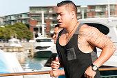 Two gentlemen of Maori decent jogging in the harbour of Auckland, New Zealand.