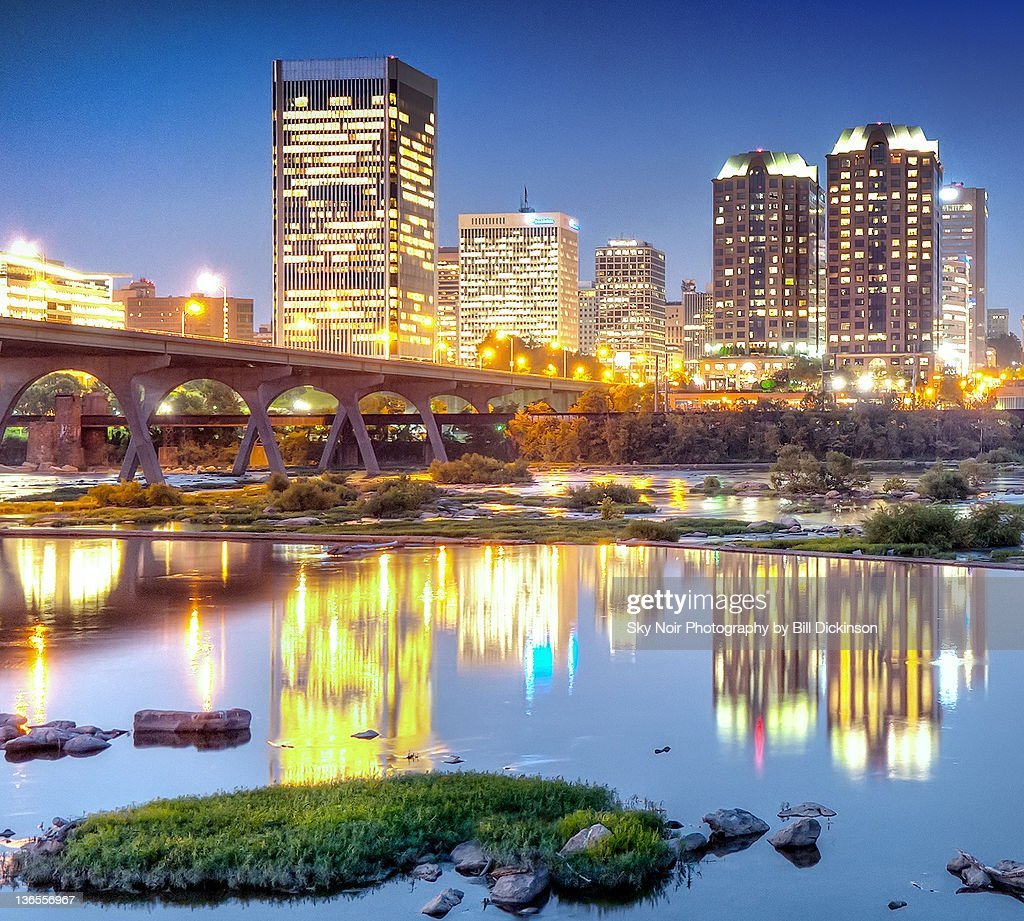 City lights reflect on James river : Stock Photo
